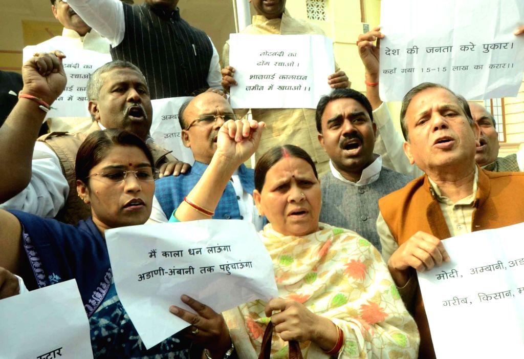 RJD legislators led by Rabri Devi stage a demonstration against Prime Minister Narendra Modi at Bihar Assembly in Patna on Nov 30, 2016. - Narendra Modi