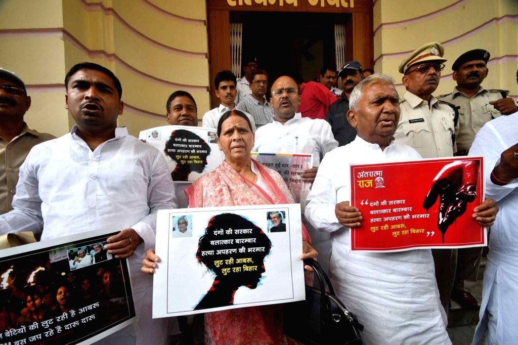 RJD legislators led by Rabri Devi stage a demonstration at Bihar Legislative Assembly, in Patna on July 24, 2018.