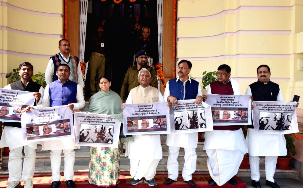 RJD legislators led by Rabri Devi stage a demonstration to press for their demands at Bihar Assembly in Patna on Feb 12, 2019.