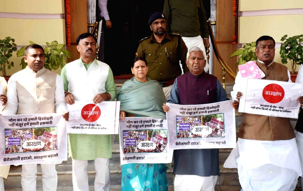RJD legislators led by Rabri Devi stage a demonstration to press for their demands at Bihar Assembly in Patna on Feb 13, 2019.