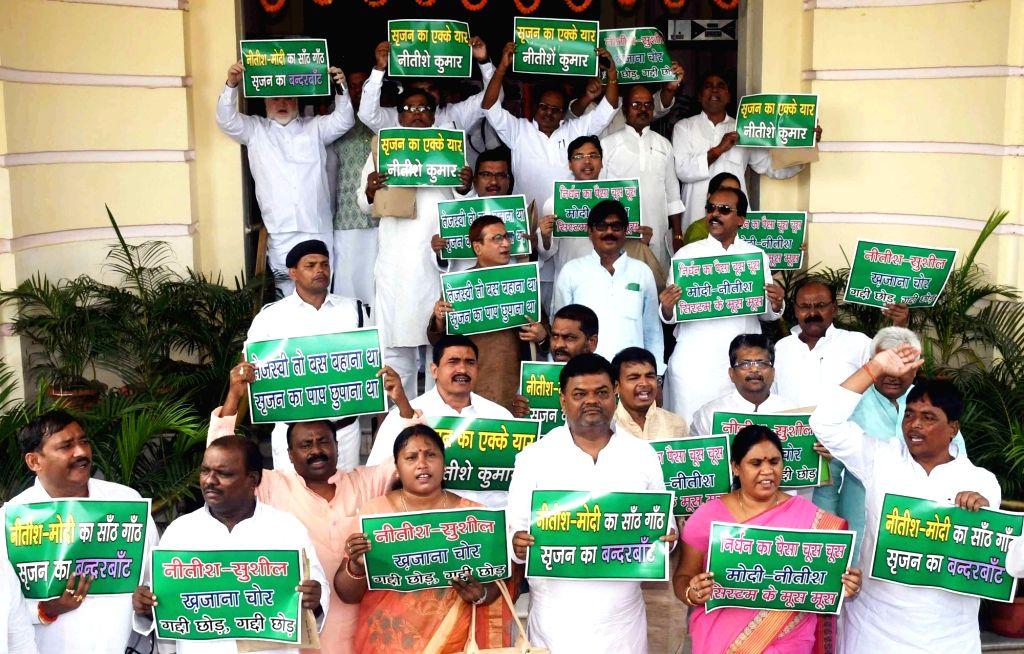 RJD legislators stage a demonstration against Nitish Kumar at Bihar Legislative Assembly in Patna on Aug 21, 2017. - Nitish Kumar