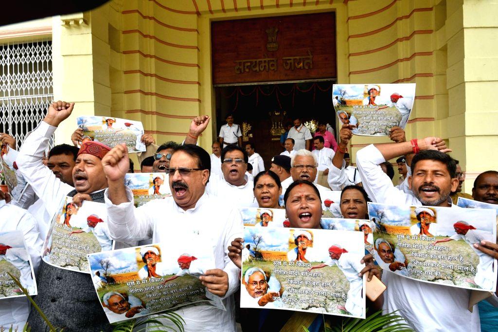 RJD legislators stage a demonstration against Prime Minister Narendra Modi and state's Chief Minister Nitish Kumar, in Patna on July 23, 2018. - Narendra Modi and Nitish Kumar