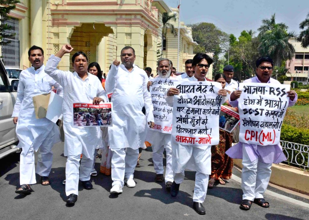 RJD legislators stage a demonstration to press for their various demands, at Bihar Assembly on April 3, 2018.