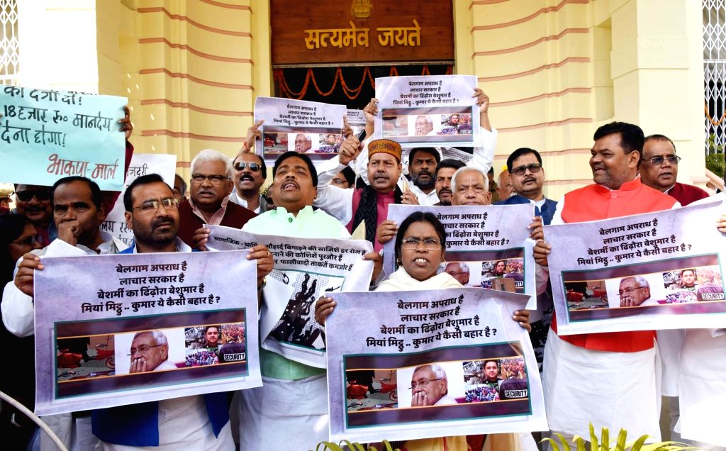 RJD legislators stage a demonstration to press for their demands at Bihar Assembly in Patna on Feb 12, 2019.