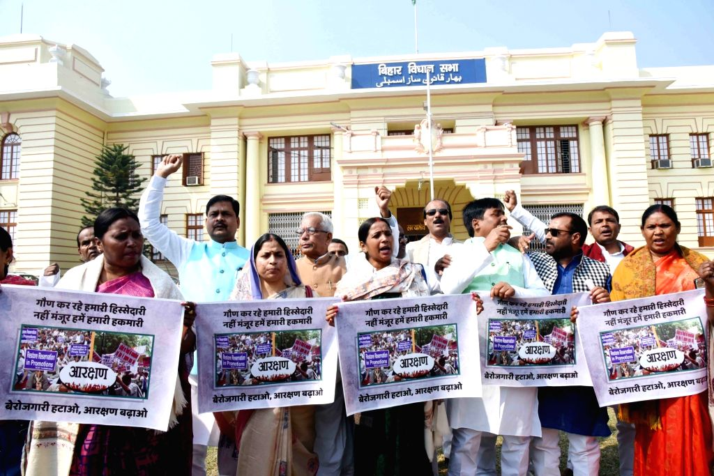 RJD legislators stage a demonstration to press for their demands at Bihar Assembly to press for their demands in Patna on Feb 13, 2019.