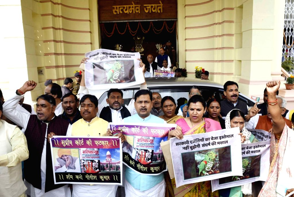 RJD legislators stage a demonstration to press for their demands at Bihar Assembly to press for their demands in Patna on Feb 14, 2019.