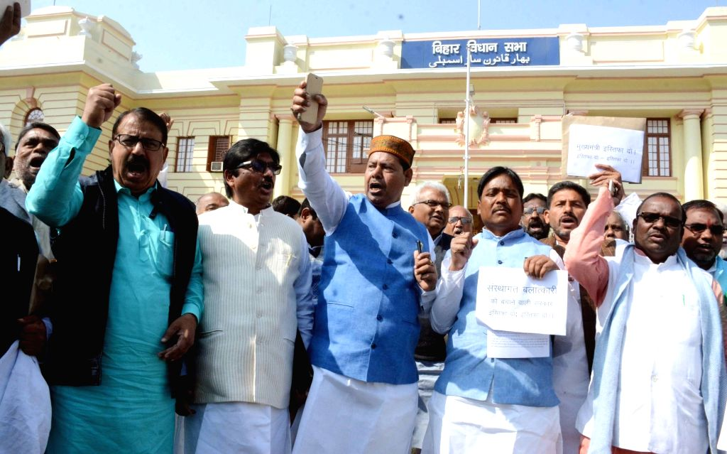 RJD legislators stage a demonstration to press for their demands at Bihar Assembly in Patna on Feb 20, 2019.