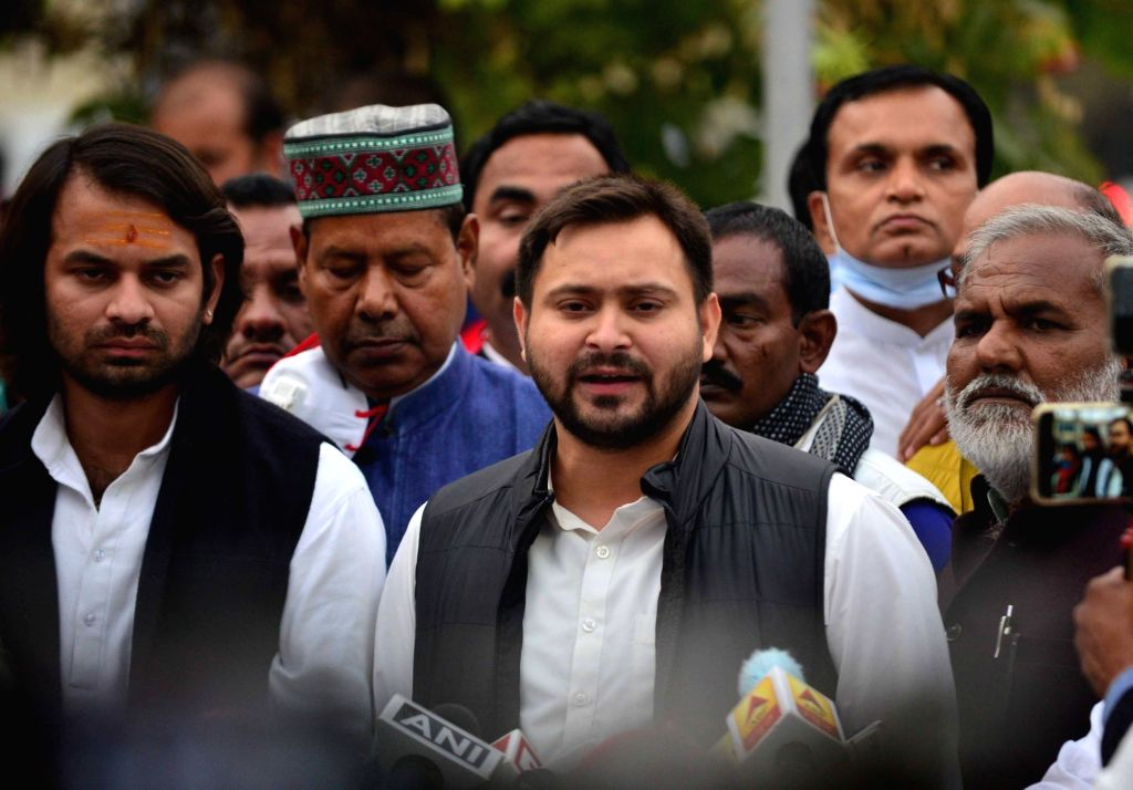 RJD MLA from Raghopur and the leader of opposition in the Bihar Legislative Assembly, Tejashwi Yadav accompanied by his elder brother and party leader Tej Pratap Yadav, talks to the media ... - Tejashwi Yadav and Tej Pratap Yadav