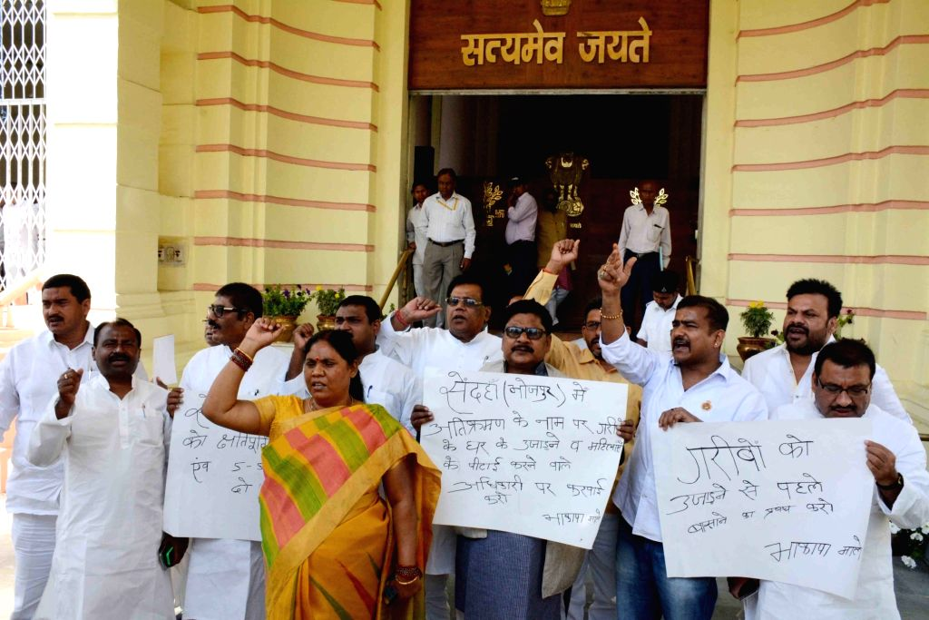 RJD MLAs stage a demonstration to press for their demands at Bihar Assembly in Patna on March 23, 2018.