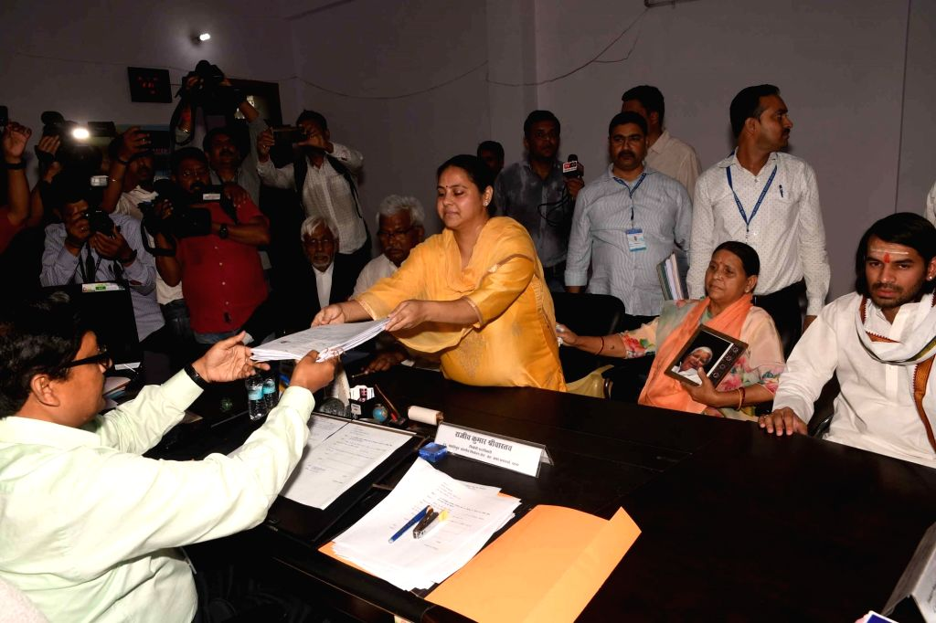 RJD's Lok Sabha candidate from Pataliputra, Misa Bharti accompanied by her mother Rabri Devi and brother Tej Pratap Yadav, files her nomination for the forthcoming Lok Sabha elections in ... - Tej Pratap Yadav