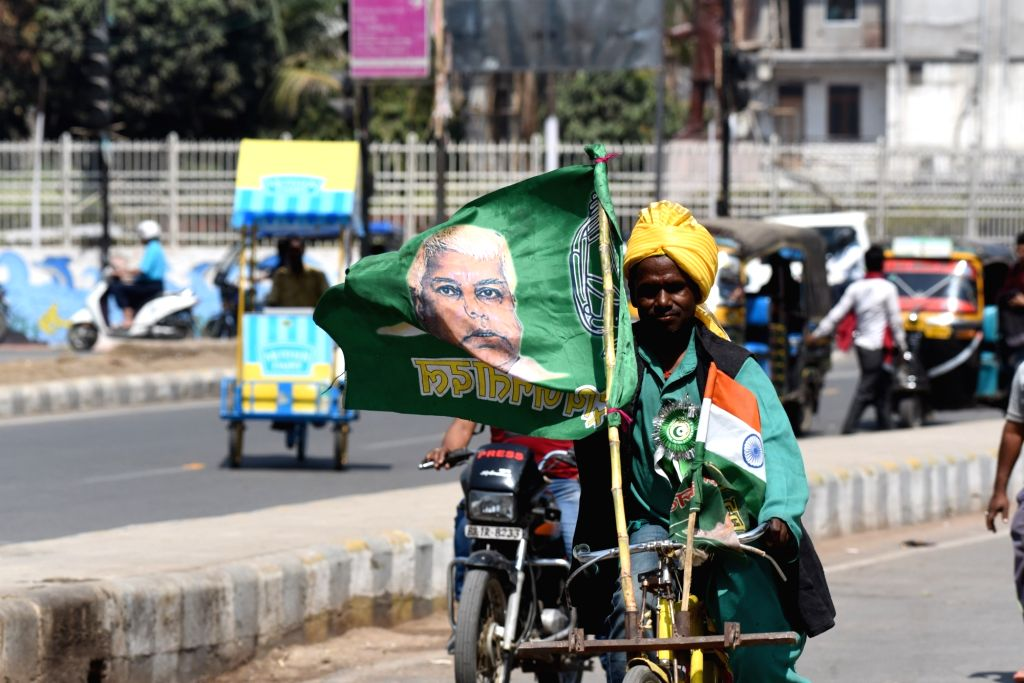 RJD supporter campaigns for the party ahead of the 2019 Lok Sabha elections, in Patna on March 12, 2019.
