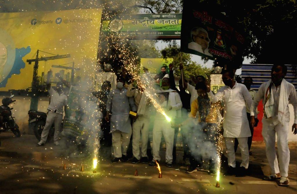 RJD supporters celebrate outside party office after Jharkhand high court granted bail to RJD leader Lalu Prasad Yadav in fodder scam case, in Patna, Saturday, April. 17, 2021 - Lalu Prasad Yadav