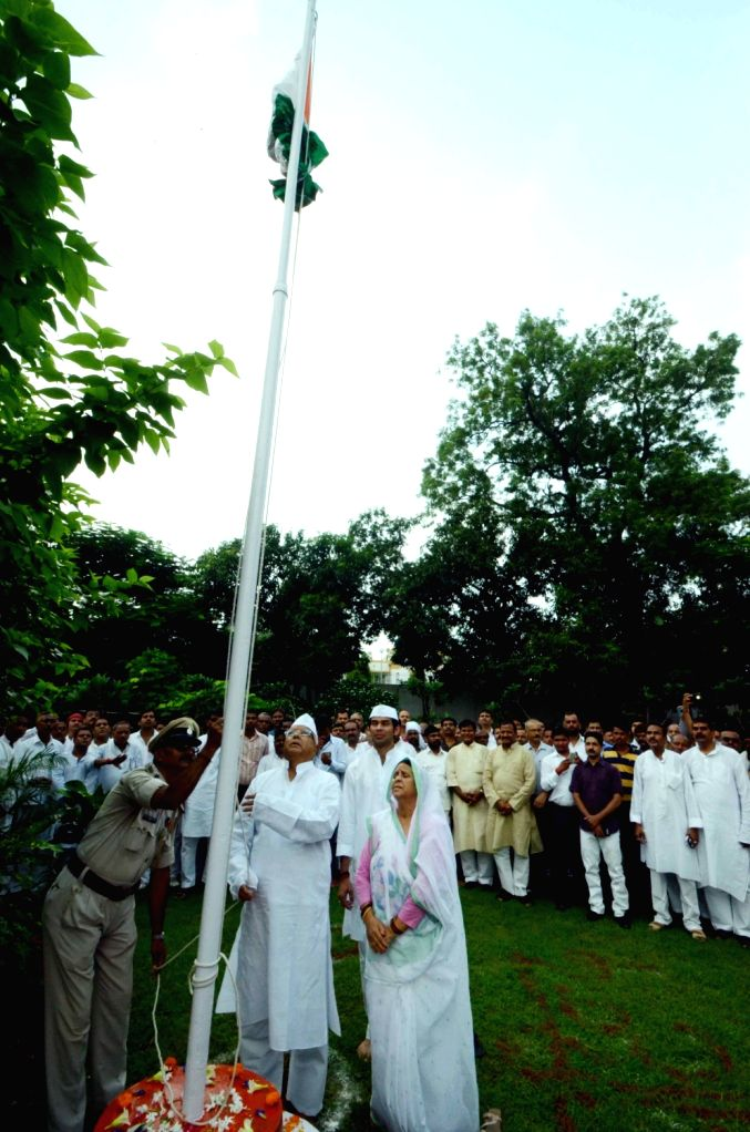 RJD supremo Lalu Yadav hoists the national flag  at his residence on Independence Day in Patna on Aug 15, 2016. - Lalu Yadav