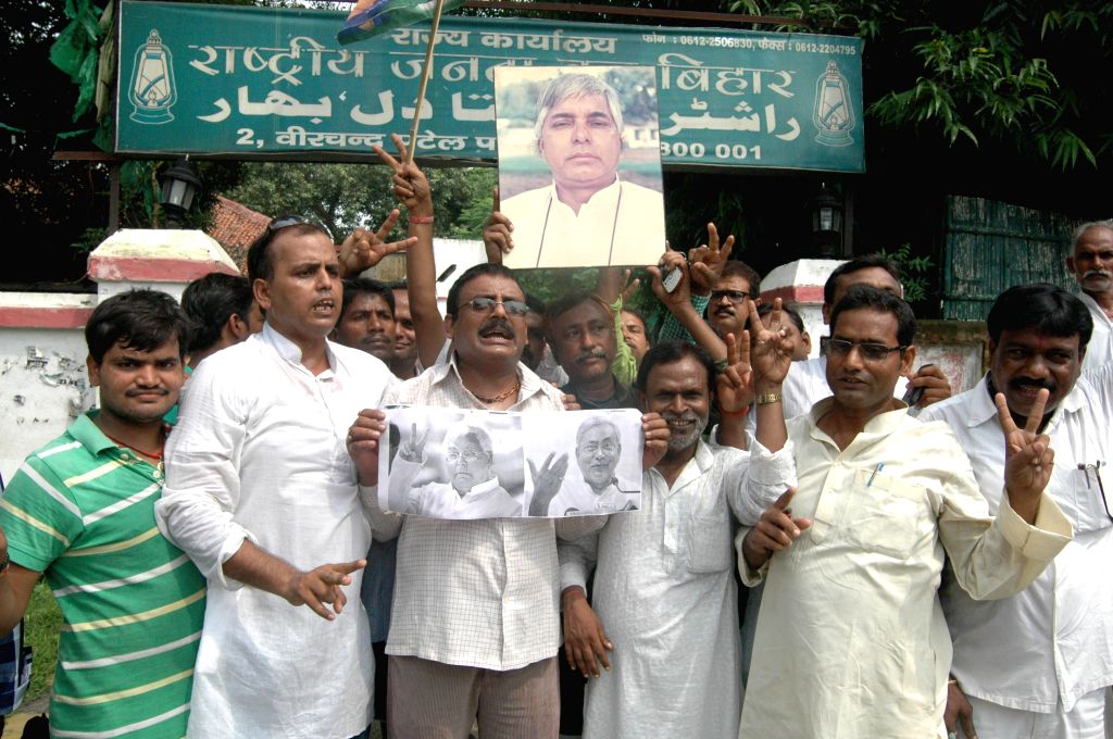 RJD workers celebrate after party won Mohiuddinnagar, Rajnagar and Chapra Lok Sabha seats in recently concluded by-polls, in Patna on Aug 25, 2014.