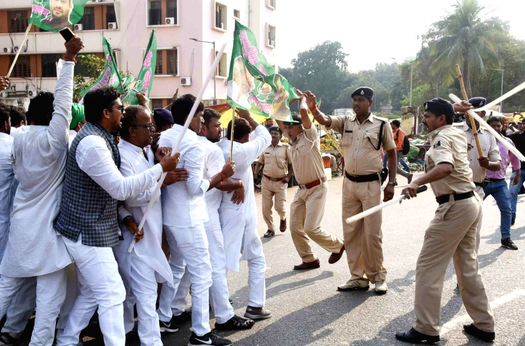 RJD workers clash with the police during the party's protest march to Raj Bhavan against the Central and the State Governments; in Patna on Nov 4, 2018.
