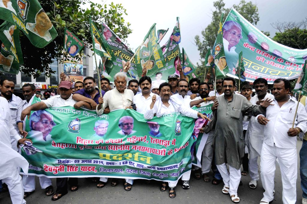 RJD workers demonstrate against rising prices of essential commodities in Patna on Aug. 9, 2014.