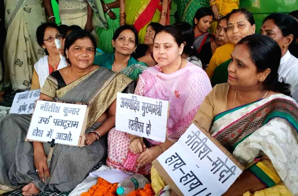 RJD workers led by party leader Misa Bharti stage a protest demanding the resignation of Bihar Social Welfare Minister Kumari Manju Verma in connection with the alleged rape of over 40 minor ... - Kumari Manju Verma