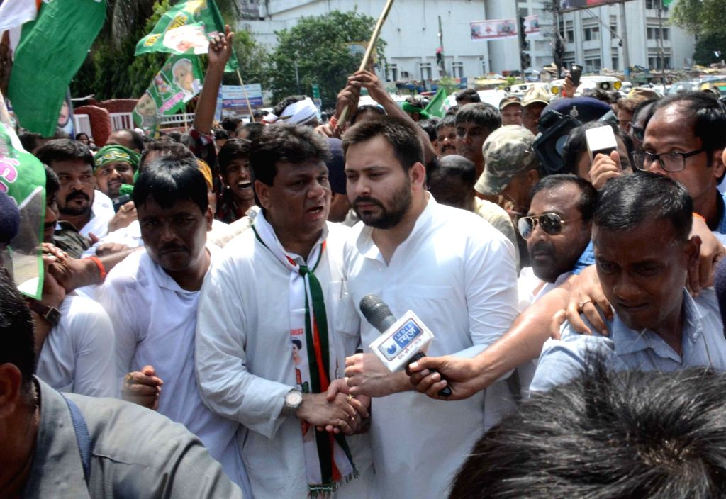 RJD workers led by Tejashwi Yadav and Kaukab Quadri  stage a demonstration during a nationwide shutdown protest or 'Bharat Bandh' against rising fuel prices called by opposition parties led by ... - Tejashwi Yadav