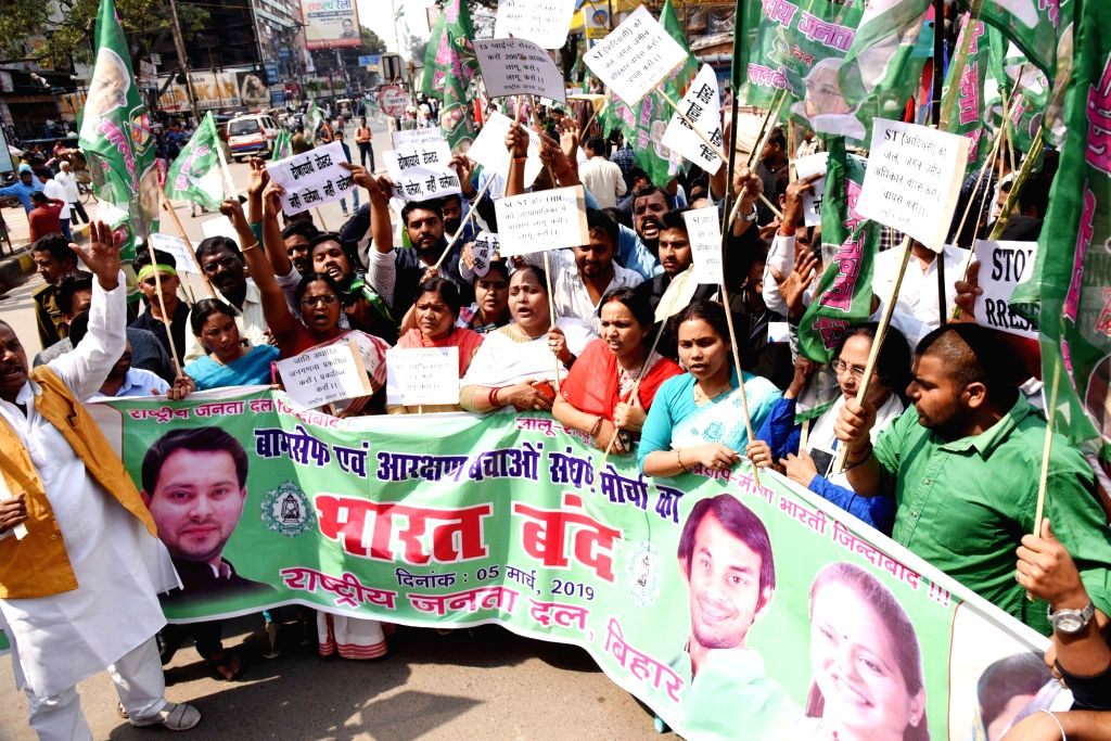 """RJD workers participate in a march during """"Bharat Bandh"""" in Patna on Feb 5, 2019."""