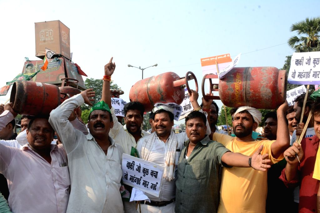 RJD workers stage a demonstration against hike in fuel prices in Patna on June 1, 2018.