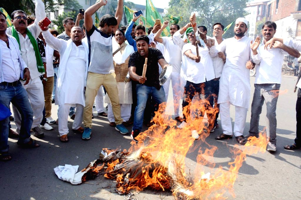 RJD workers stage a demonstration against the hike in fuel prices; in Patna on Sept 8, 2018.