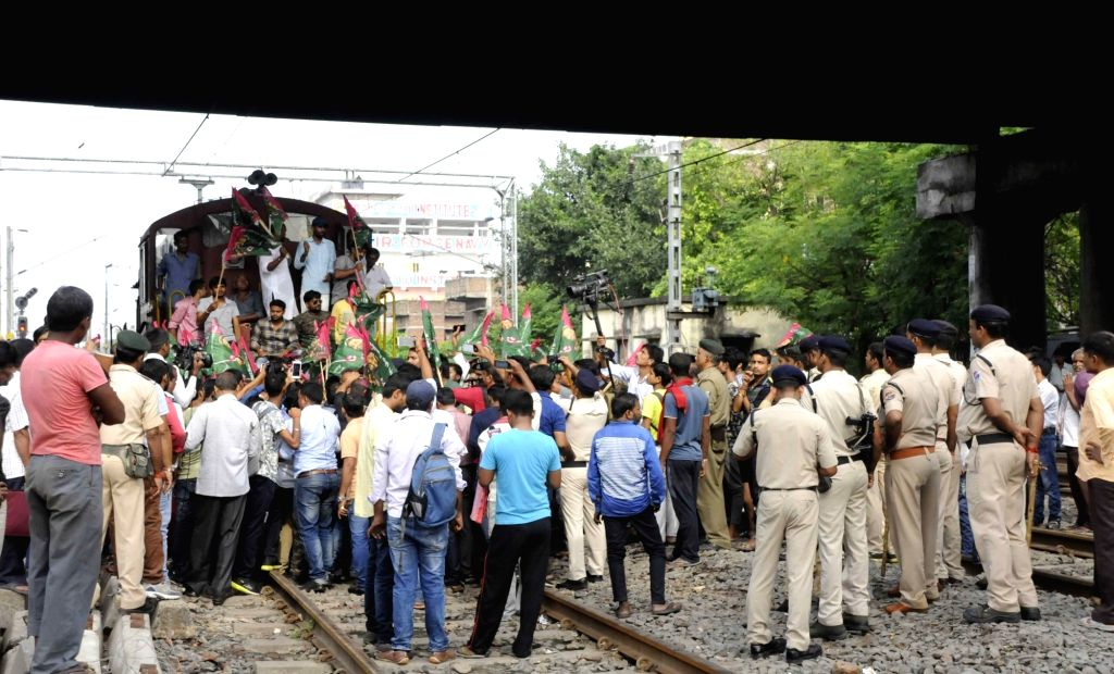 RJD workers stage a demonstration as they block railway tracks and disrupt railway services during a nationwide shutdown protest - 'Bharat Bandh' against rising fuel prices called by ...