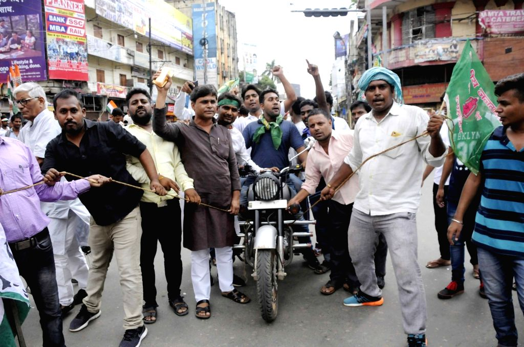 RJD workers stage a demonstration during a nationwide shutdown protest - 'Bharat Bandh' called by opposition parties led by Congress against rising fuel prices, in Patna on Sept 10, 2018.