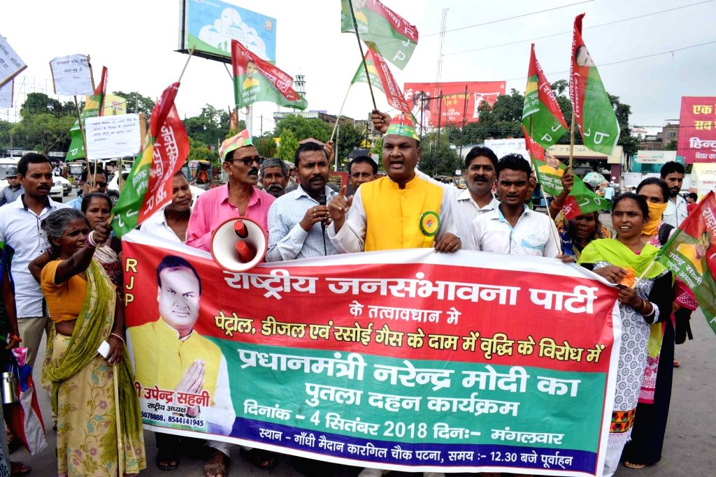 RJD workers stage a demonstration to protest against hike in fuel prices in Patna on Sept 4, 2018.