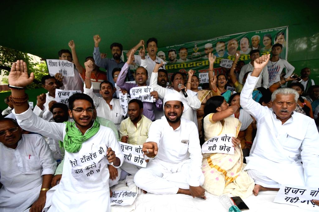 RJD workers stage a protest over Srijan scam in Patna on Sept 12, 2017.