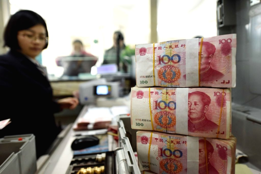 RMB banknotes. (File Photo: Xinhua/IANS)