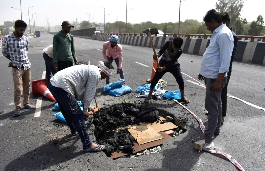 Road repair work underway after a large four feet hole which appears on the Hero Honda Chowk flyover on the Delhi-Jaipur stretch of the National Highway 8, in Gurugram, on May 8, 2019.