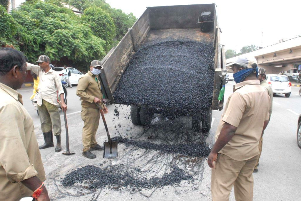 Road repair work underway after the city's roads developed several potholes during the ongoing monsoon season, in Hyderabad on July 18, 2018.