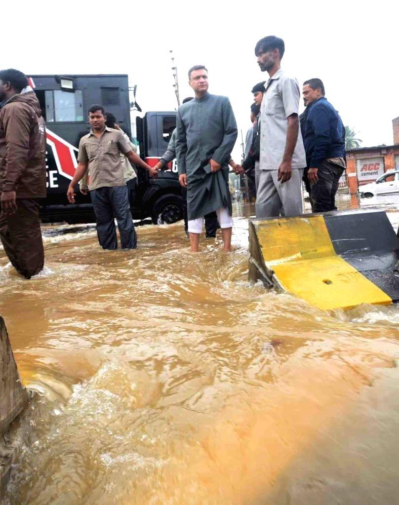 Roads blocked due to heavy rain flood water in Hafeez Baba Nagar in Hyderabad on October 18, 2020.