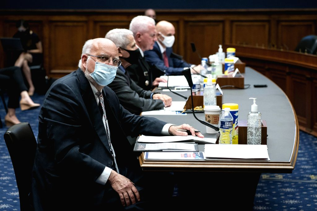 Robert Redfield (1st L), director of the U.S. Centers for Disease Control and Prevention, prepares to testify before the House Energy and Commerce Committee on ...