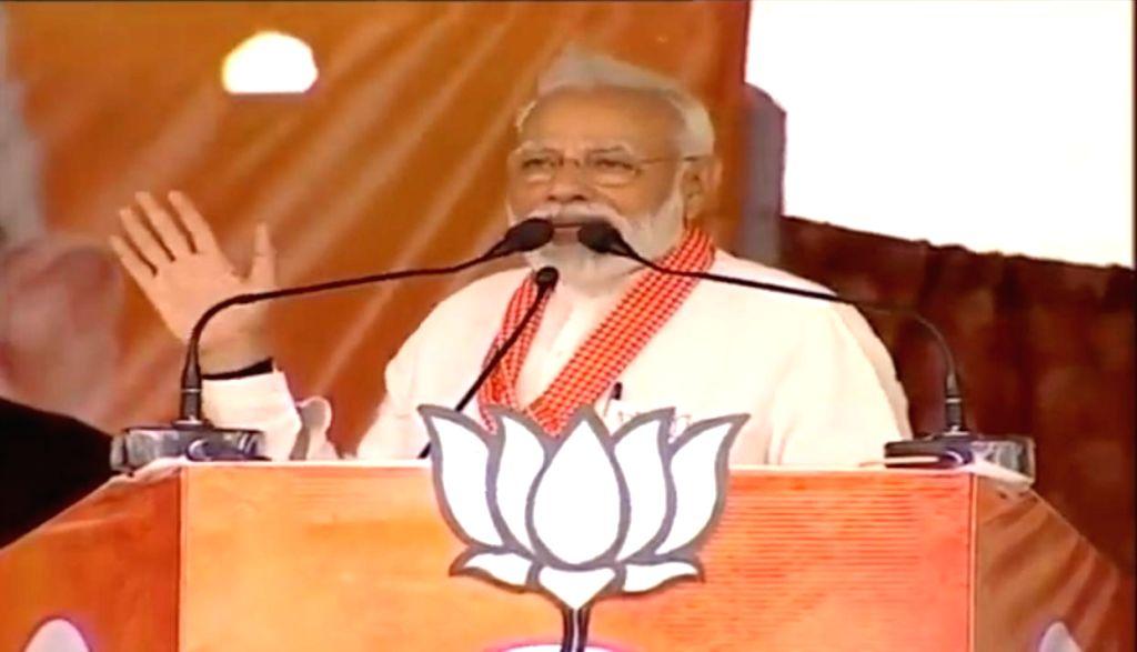 Robertsganj: Prime Minister Narendra Modi addresses a public rally in Robertsganj, Uttar Pradesh on May 11, 2019. (Photo: IANS) - Narendra Modi