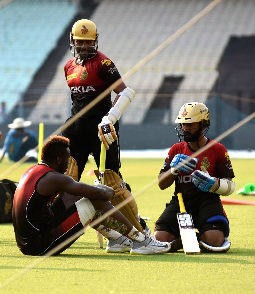 Robin Uthappa, Dinesh Karthik and Andre Russell of Kolkata Knight Riders (KKR) during a practice session at Eden Gardens in Kolkata, on April 13, 2018.