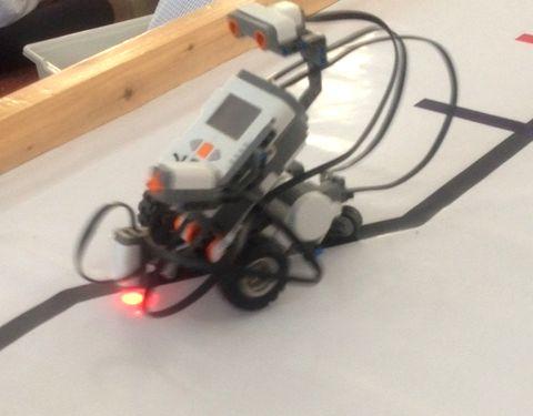 Robot programmed to walk on black color