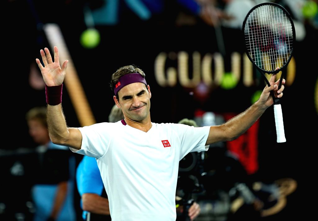 Roger Federer of Switzerland celebrates after winning the men's singles fourth round match against Marton Fucsovics of Hungary at the Australian Open tennis ...