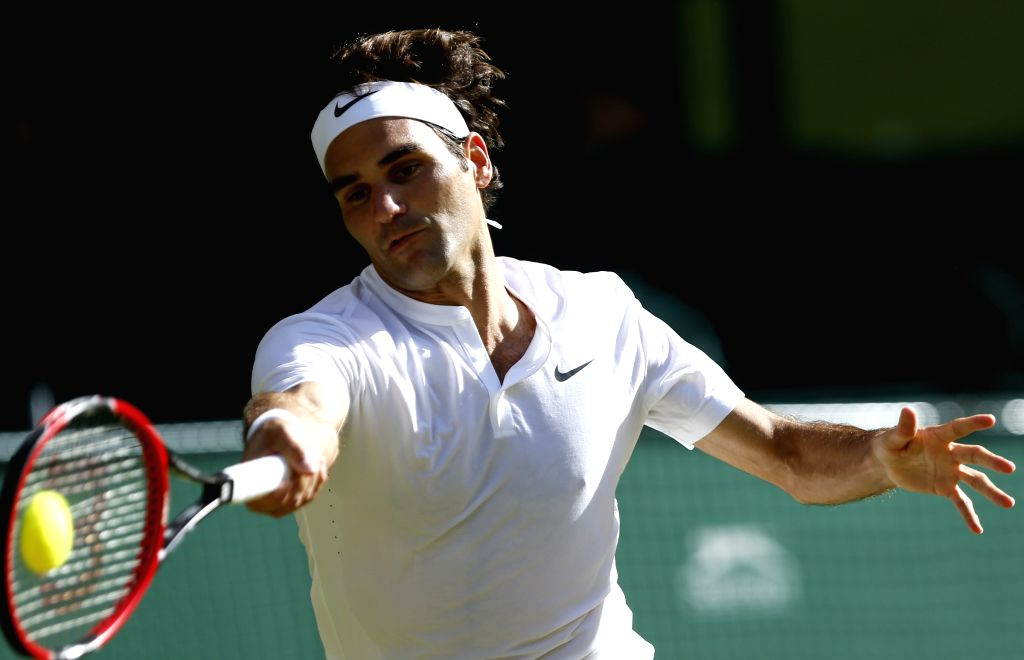 Roger Federer of Switzerland competes during the men's singles semifinal against Andy Murray of Britain at the 2015 Wimbledon Championships in Wimbledon, southwest ...