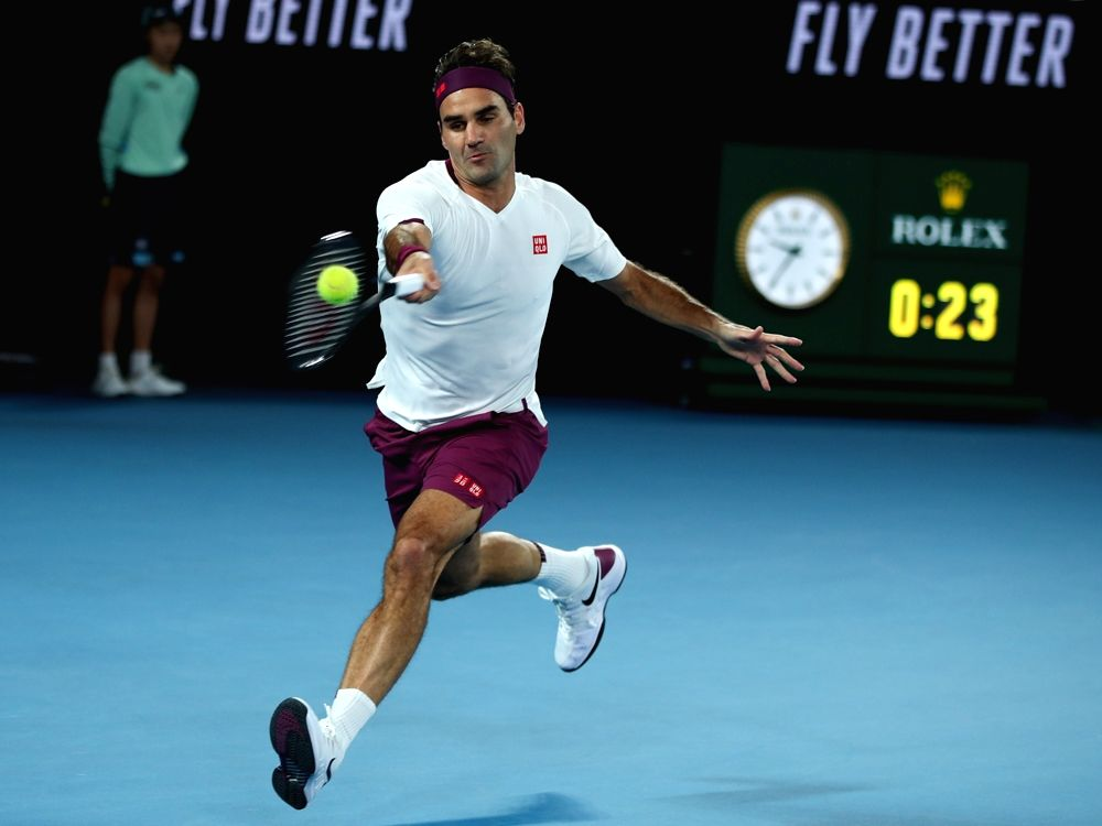 Roger Federer of Switzerland hits a return during the men's singles fourth round match against Marton Fucsovics of Hungary at the Australian Open tennis ...