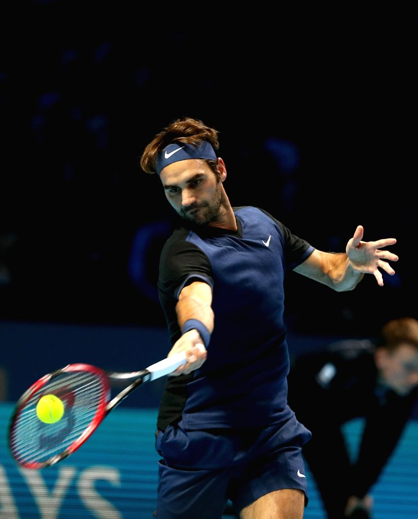 Roger Federer of Switzerland returns a ball during the men's singles final against Novak Djokovic of Serbia at the ATP World Tour Finals at the O2 Arena in London, ...