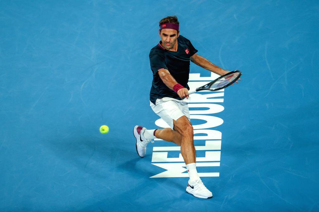 Roger Federer of Switzerland returns a shot during the men's singles third round match against John Millman of Australia at the 2020 Australian Open tennis ...