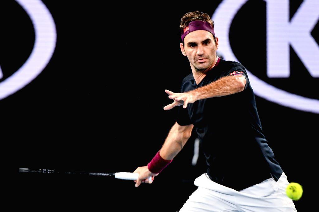 Roger Federer returns a shot during the men's singles third round match between Roger Federer of Switzerland and John Millman of Australia at the 2020 Australian ...