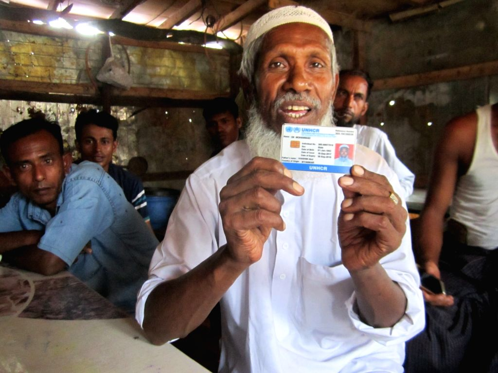 Rohingya refugee Dil Mohammad displays his identity card of the United Nations High Commissioner for Refugees (UNHCR) at a refugee camp in Jammu city of Jammu and Kashmir.