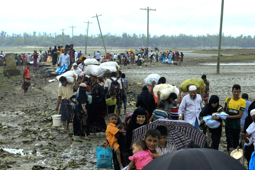Rohingya refugees arrive at Shah Porir Dwip in Dakhinpara ofBangladesh from Rasidong in Myanmar, on Sept 13, 2017.