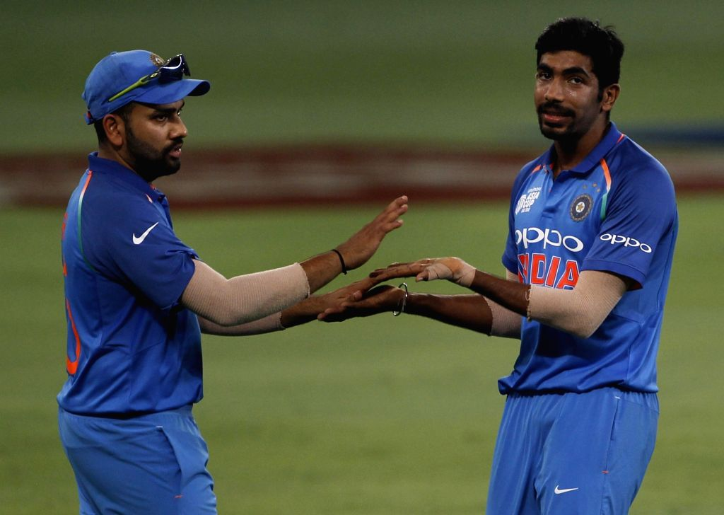 Rohit Sharma and Jasprit Bumrah. (Photo: Surjeet Yadav/IANS) - Rohit Sharma and Surjeet Yadav