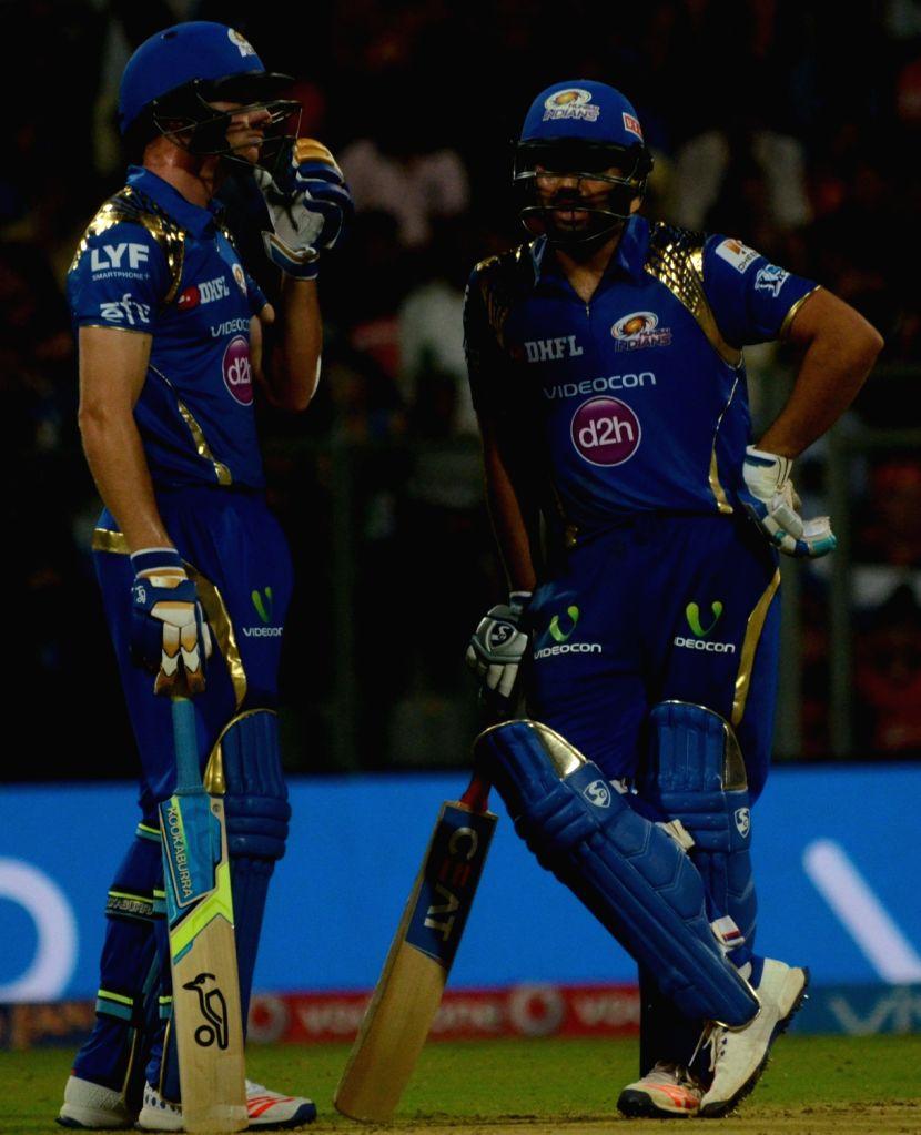Rohit Sharma and Jos Buttler of Mumbai Indians  during IPL match between  Mumbai Indians and Royal Challengers Bangalore at Wankhede Stadium in Mumbai on April 20, 2016. - Rohit Sharma