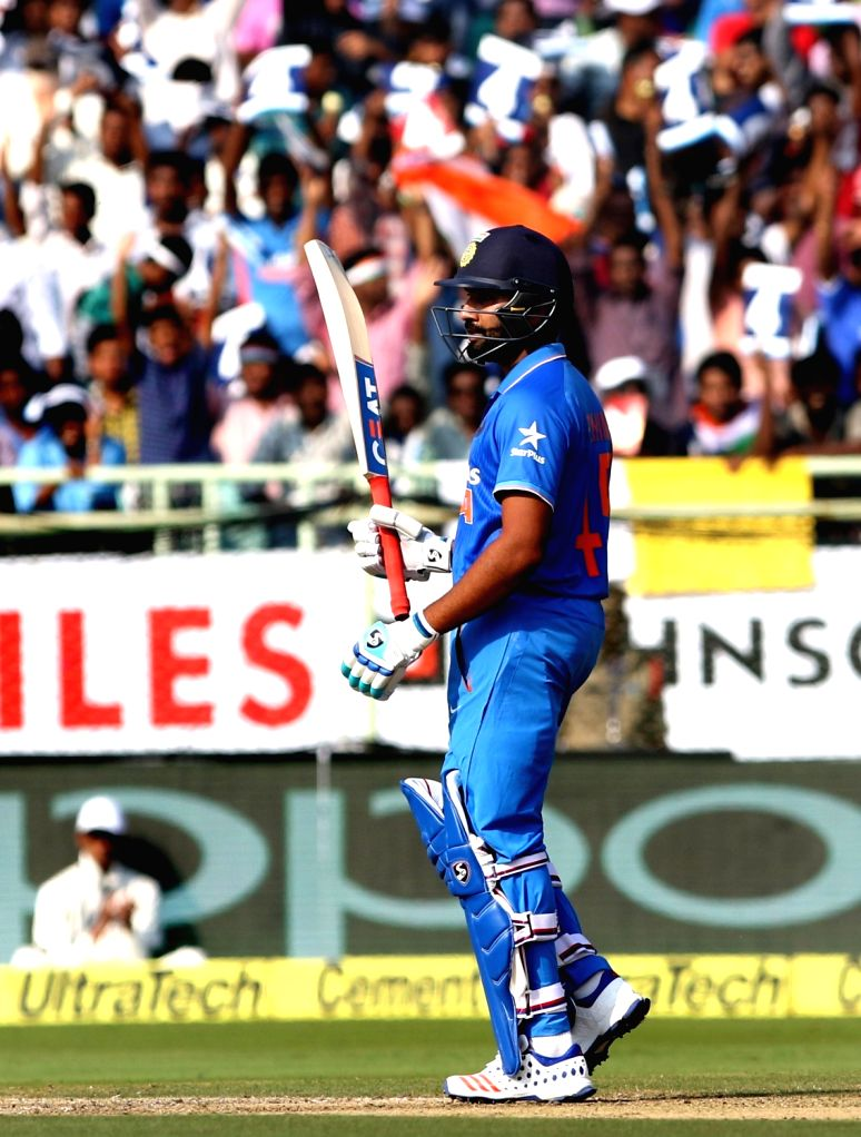 Rohit Sharma of India celebrates his half century during the fifth ODI match between India and New Zealand at Dr. Y.S. Rajasekhara Reddy ACA-VDCA Cricket Stadium in Visakhapatnam on ... - Rohit Sharma