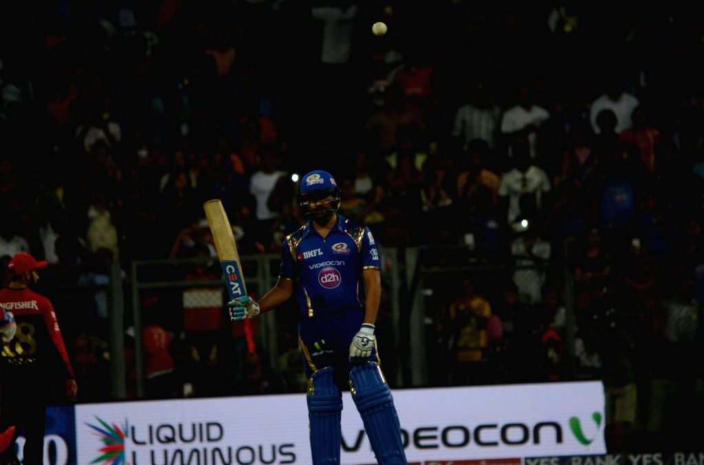 Rohit Sharma of Mumbai Indians celebrates his half century during IPL match between  Mumbai Indians and Royal Challengers Bangalore at Wankhede Stadium in Mumbai on April 20, 2016. - Rohit Sharma