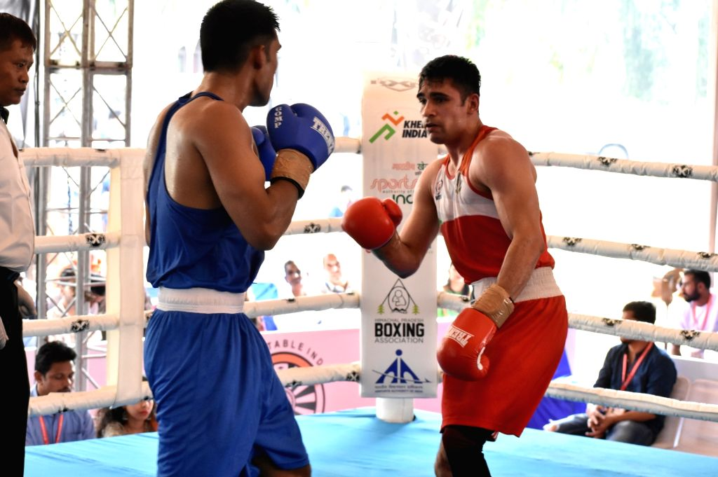 Rohit Tokas in action against Rohit of All India Police during the Semi-finals in the 75 Kg category of 4th Elite National Men's Boxing Championship at Baddi University, in Baddi of Himachal ...